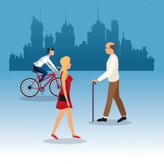 Chodząca kobieta starego człowieka potomstw przejażdżki roweru miasta tła miasta tło
