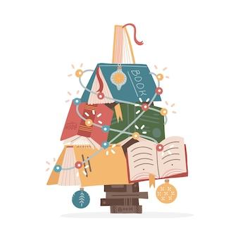 Choinka wykonana z kolorowych książek i bombek świątecznych i girlandy śliczna jasna konstrukcja książek domowa li...