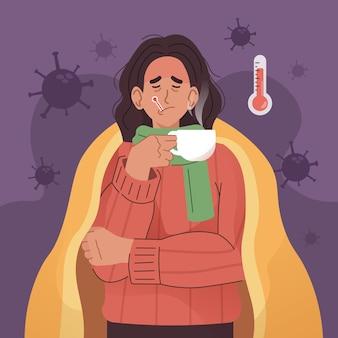 Chora kobieta pije ciepłą wodę z kocem