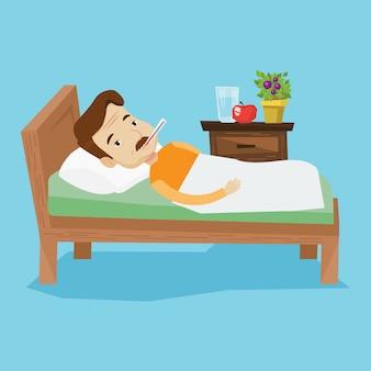 Chory człowiek z termometrem r. w łóżku.