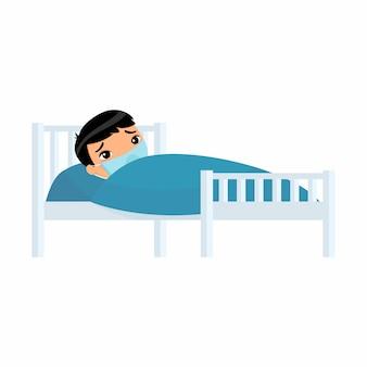 Chory mały azjatycki chłopiec z maską medyczną w szpitalnym łóżku. dziecko z postacią z kreskówki choroby wirusowej.