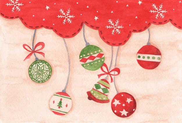 Christmas ball wiszące na tle czerwonego nieba sezon zimowy na wesołych świąt i szczęśliwego nowego roku. akwarela boże narodzenie