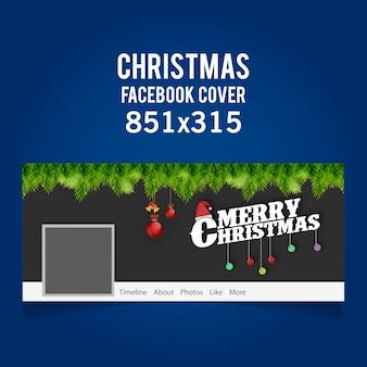 Christmas facebook cover zawierająca typograhy, wiszące kulki i dzwonki oraz trawę na ciemnym szarym tle