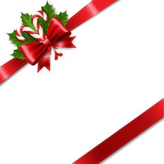 Christmas ribbon bow z holly berry czerwonym tle