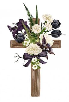 Chrześcijański drewniany krzyż ozdobiony kwiatami i liśćmi