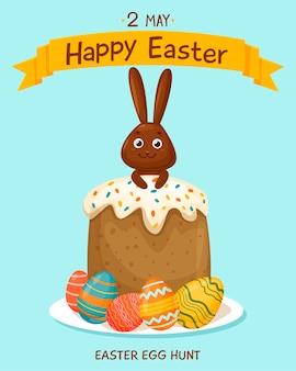 Ciasto wielkanocne utwardzane polewą i jasnymi elementami. malowane jajka z czekoladowym króliczkiem.