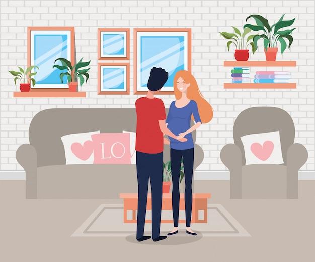 Ciążowa para na scenie w salonie