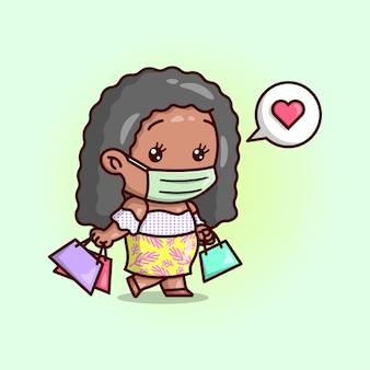Ciemna skóra kręcone włosy kobieta nosiąca maskę i przynosić torbę na zakupy kartonowe ilustracje.