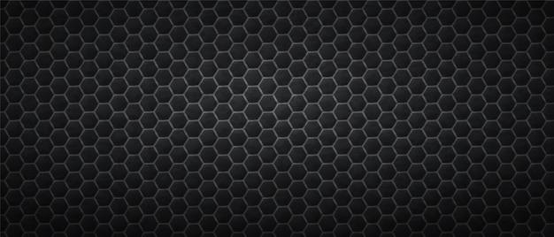 Ciemne tło sześciokątów o strukturze plastra miodu. wielokątne czarne płytki gradientowe ułożone w abstrakcyjnej teksturze