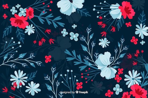 Ciemne tło z czerwonymi i niebieskimi kwiatami