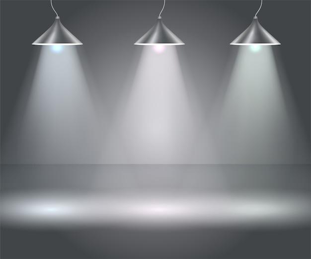Ciemne tło z reflektorami. studio.