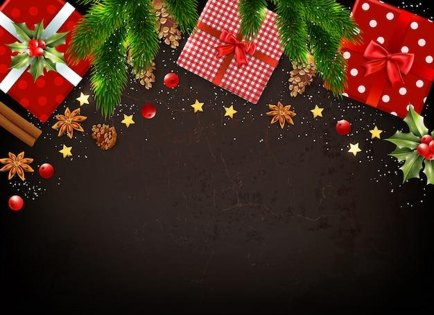 Ciemne tło z różnymi kolorowymi symbolami świątecznymi, takimi jak pudełka na prezenty jemioła, pozostawia gałęzie jodły realistyczne