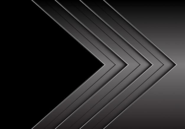Ciemnoszary metaliczny kierunek strzałki pokrywają się z czarnym tłem pustej przestrzeni.