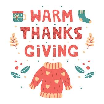 Ciepła ręka rysująca dziękczynienie literowanie, ilustracja. wydrukuj płaską kartę. ilustracja kreskówka styl z sweter, skarpety, filiżanki herbaty i liści. święto dziękczynienia.