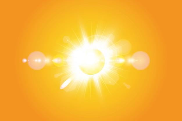Ciepłe słońce na żółtym tle. lato. blask. promienie słoneczne.