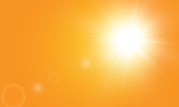 Ciepłe słońce na żółtym tle. leto.bliki promienie słoneczne. pomarańczowe żółte tło.