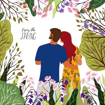 Ciesz się wiosną. młoda para, kwiaty i drzewa