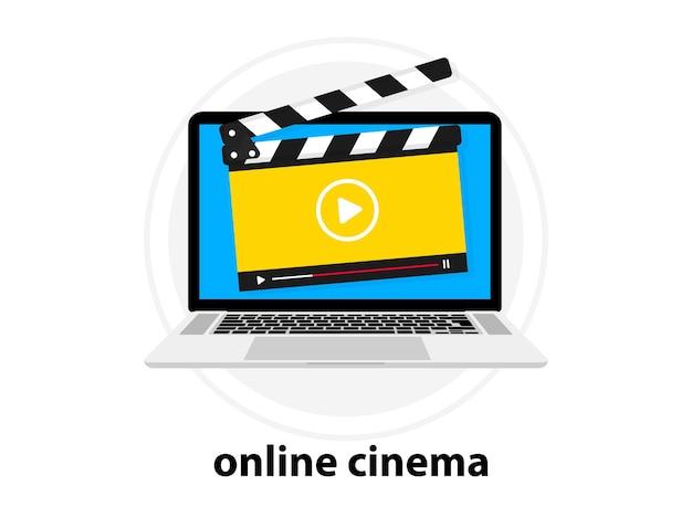 Clapperboard z odtwarzaczem wideo online. instrukcja wideo. film online. kino online odtwarzacza wideo z klapą. laptop z odtwarzaczem wideo na ekranie. notatnik z oknem transmisji na żywo