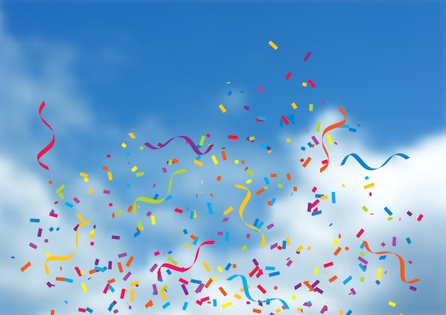 Confetti i streamers na niebieskiego nieba tle