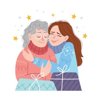 Córka przytula matkę i życzy jej wesołych świąt i szczęśliwego nowego roku.
