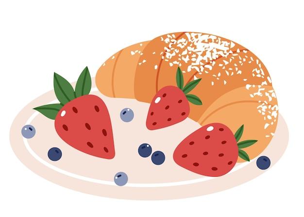 Croissant na talerzu posypany cukrem pudrem i jagodami