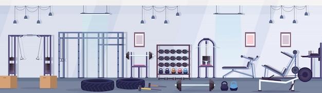 Crossfit studio klub zdrowia ze sprzętem do ćwiczeń koncepcja zdrowego stylu życia pusty brak ludzi siłownia wnętrze urządzenia treningowe poziomy baner