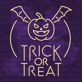 Cukierek albo psikus halloweenowy napis w świetle neonu z latającą dynią