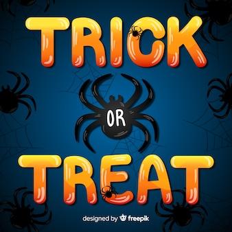 Cukierek albo psikus napis czarnym pająkiem