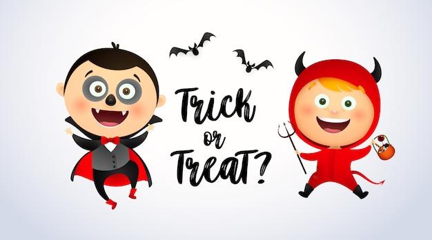 Cukierek albo psikus napis z dziećmi w kostiumach draculi i diabła