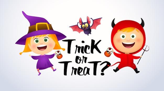 Cukierek albo psikus napis z dziećmi w strojach czarownic i diabłów