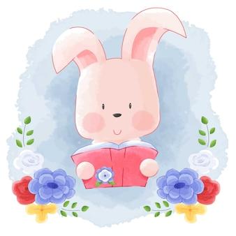 Cute animal bunny rabbit reading book z kwiat ramą akwareli tle.