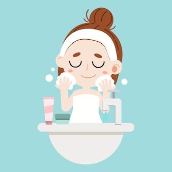 Cute cartoon dziewczyna mycia twarzy na niebieskim tle.
