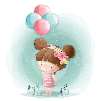 Cute little girl holding balony