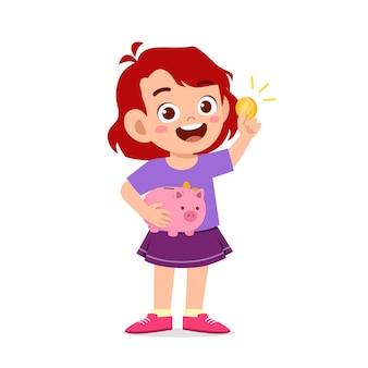 Cute little kid girl nosić skarbonkę i złotą monetę