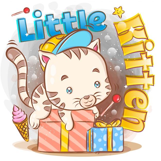 Cute little kitten z prezentem urodzinowym