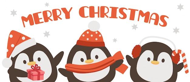 Cute pingwina w boże narodzenie z tekstem wesołych świąt. kartka z życzeniami
