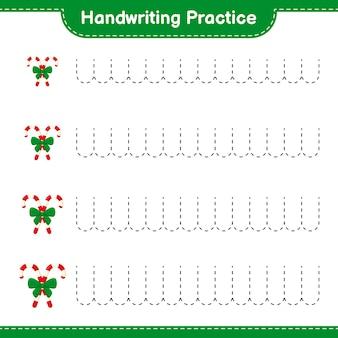 Ćwiczenia pisma ręcznego. śledzenie linii candy canes with ribbon. gra edukacyjna dla dzieci, arkusz do druku