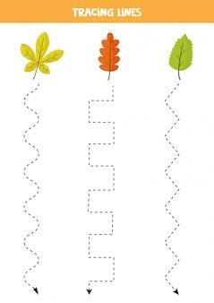 Ćwiczenia pisma ręcznego ze spadającymi jesiennymi liśćmi. śledzenie linii