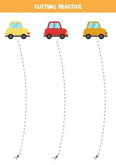 Ćwiczenie cięcia dla dzieci w wieku przedszkolnym. przecięte linią przerywaną. śliczne kolorowe samochody.