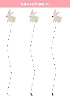 Ćwiczenie cięcia dla dzieci w wieku przedszkolnym. przecięte linią przerywaną. śliczny królik.