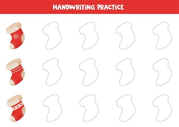 Ćwiczenie pisma ręcznego ze skarpetkami świątecznymi. śledzenie konturów. ćwiczenie umiejętności pisania.