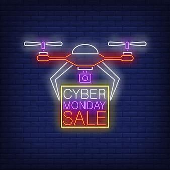 Cyber poniedziałek wyprzedaż neonowy tekst w ramce przenoszony przez drona