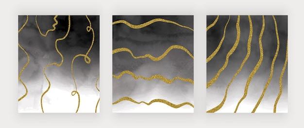 Czarna akwarela tekstury ze złotymi brokatowymi liniami odręcznymi