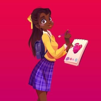 Czarna kobieta malarz z notatnikiem i ołówkiem
