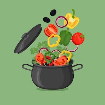 Czarna patelnia z wrzącą wodą i warzywami