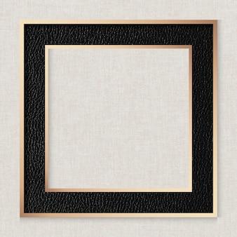 Czarna skórzana ramka na beżowym tle tekstury tkaniny