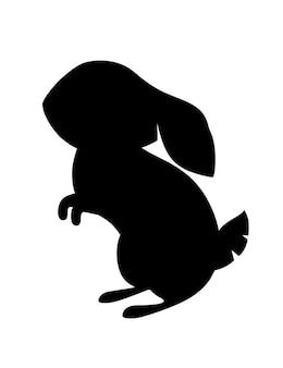 Czarna sylwetka ładny szary królik siedzi na ziemi kreskówka projekt płaski wektor ilustracja na białym tle.