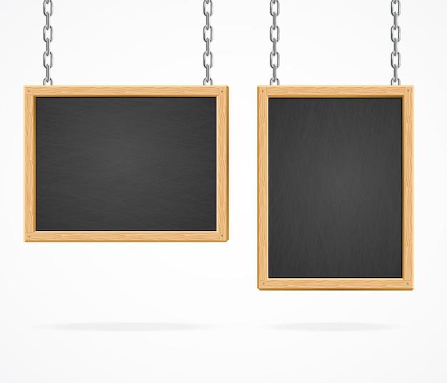 Czarna tablica znak wiszący na łańcuchach na białym tle