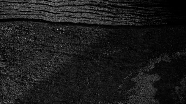 Czarne drewniane teksturowane tło projektu