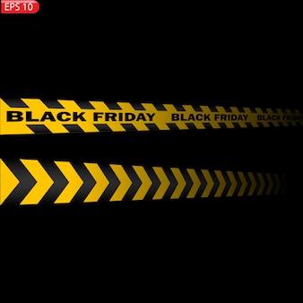 Czarne i żółte linie ostrzegawcze na białym tle. realistyczne taśmy ostrzegawcze. wyprzedaż w czarny piątek
